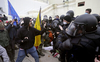 Trump supporters try to break through a police barrier, January 6, 2021, at the US Capitol in Washington. (AP Photo/Julio Cortez)