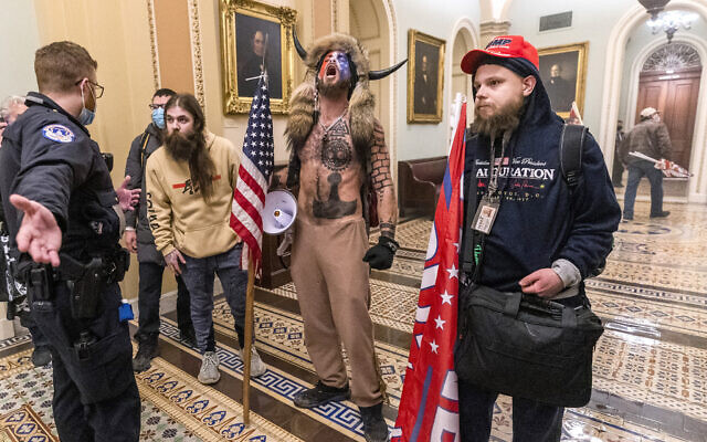 Supporters of US President Donald Trump are confronted by Capitol Police officers outside the Senate Chamber inside the Capitol, January 6, 2021 in Washington. (AP Photo/Manuel Balce Ceneta)
