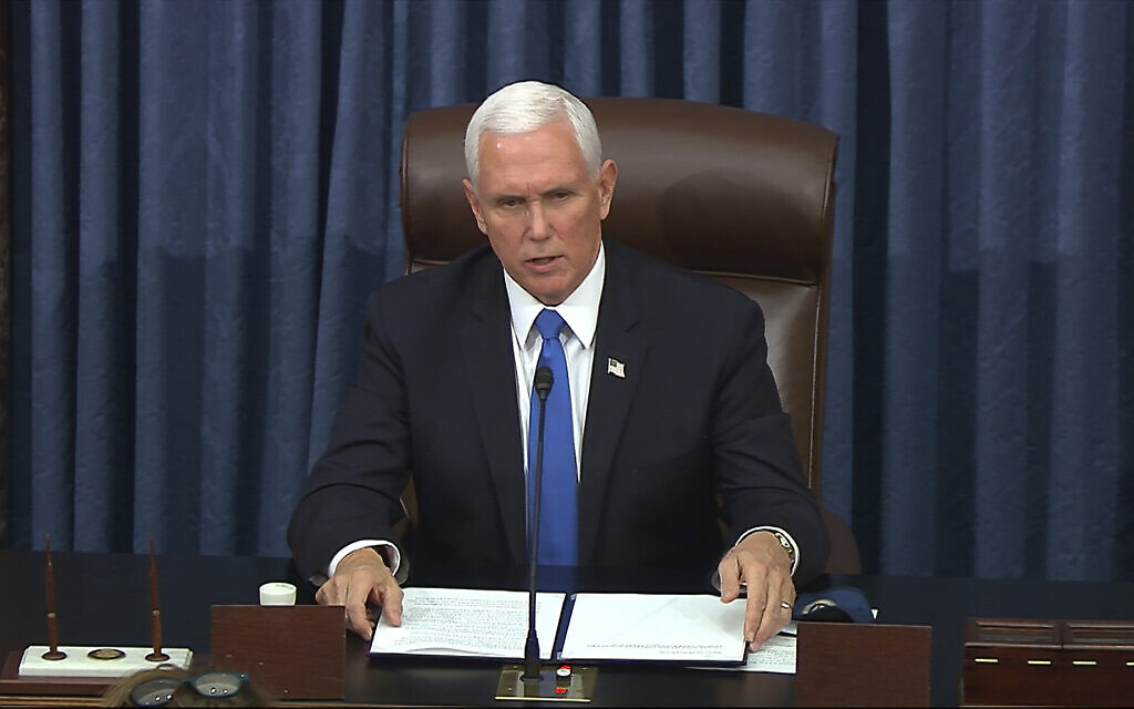 In this image from video, US Vice President Mike Pence speaks as the Senate reconvenes after protesters stormed into the US Capitol on Wednesday, Jan. 6, 2021. (Senate Television via AP)