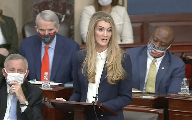 In this image from video, Sen. Kelly Loeffler, R-Ga., speaks as the Senate reconvenes after protesters stormed into the U.S. Capitol on Wednesday, Jan. 6, 2021. (Senate Television via AP)