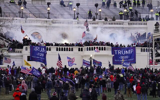Violent protesters loyal to US President Donald Trump storm the Capitol, January 6, 2021, in Washington. (AP Photo/John Minchillo)