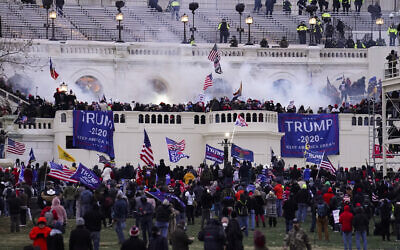 Violent protesters, loyal to US President Donald Trump, storm the Capitol, January 6, 2021, in Washington. (AP Photo/John Minchillo)