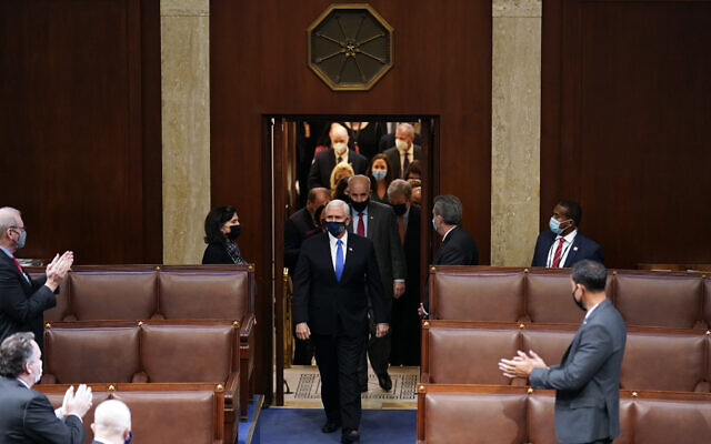 Vice President Mike Pence walks onto the House floor to officiate a joint session of the House and Senate to confirm Electoral College votes at the Capitol, Jan 7, 2021, in Washington. (AP Photo/Andrew Harnik)