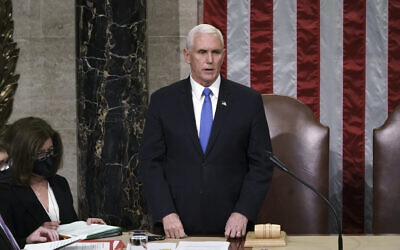 US Vice President Mike Pence listens after reading the final certification of Electoral College votes cast in November's presidential election during a joint session of Congress after working through the night, at the Capitol in Washington, January 7, 2021. (J. Scott Applewhite/AP)