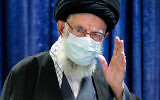 In this picture released by an official website of the office of the Iranian supreme leader, Supreme Leader Ayatollah Ali Khamenei waves before he addresses the nation in a televised speech in Tehran, Iran, Friday, Jan. 8, 2021. in Tehran, Iran. Khamenei called to ban the import of American and British vaccines, claiming they are not to be trusted. (Office of the Iranian Supreme Leader via AP)