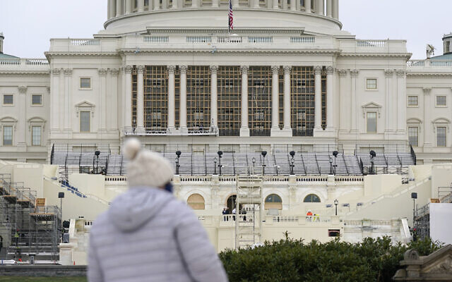 Preparations take place for US President-elect Joe Biden's inauguration on the West Front of the U.S. Capitol in Washington, Friday, Jan. 8, 2021, after supporters of President Donald Trump stormed the building. (AP Photo/Patrick Semansky)