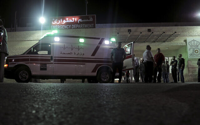 In this Nov. 6, 2019 file photo, an ambulance is parked in front of the Jerash Government Hospital, where people stabbed in a knife attack were taken in Jerash, Jordan (AP Photo/Raad Adayleh, File)