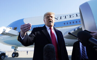 US President Donald Trump speaks to the media before boarding Air Force One, at Andrews Air Force Base, Maryland, January 12, 2021. (AP Photo/Alex Brandon)
