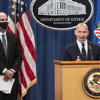 Steven D'Antuono, head of the Federal Bureau of Investigation (FBI) Washington field office, left, listens as acting US Attorney Michael Sherwin, speaks during a news conference January 12, 2021, in Washington. (Sarah Silbiger/Pool via AP)