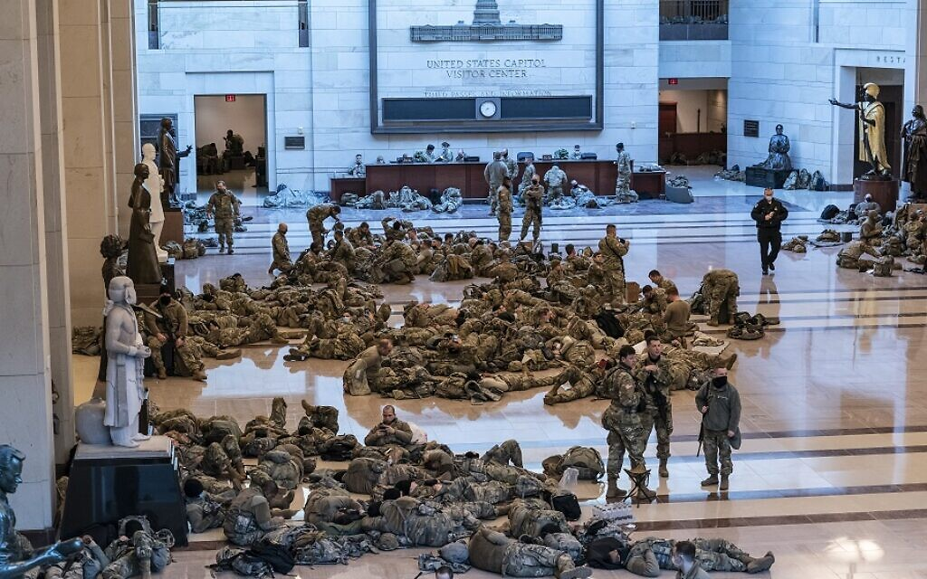 Hundreds of National Guard troops holed inside the Capitol Visitor's Center to reinforce security at the Capitol in Washington, Wednesday, Jan. 13, 2021. The House of Representatives is pursuing an article of impeachment against President Donald Trump for his role in inciting an angry mob to storm the Capitol last week. (AP Photo/J. Scott Applewhite
