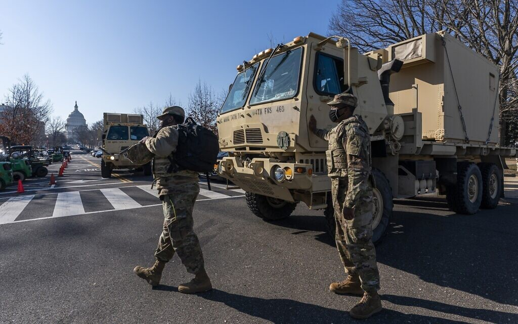 Members of the National Guard secure the perimeter around the Capitol, Wednesday, Jan. 13, 2021, in Washington as the House of Representatives continues with its fast-moving House vote to impeach President Donald Trump, a week after a mob of Trump supporters stormed the US Capitol. (AP Photo/Manuel Balce Ceneta)