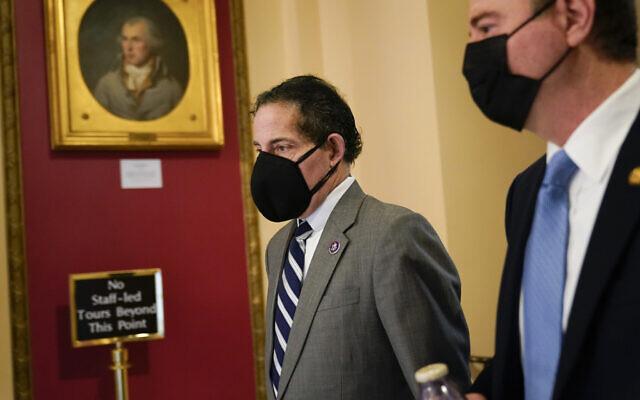 Rep. Jamie Raskin, D-Md., left, walks with Rep. Adam Schiff, D-Calif., on Capitol Hill in Washington, Wednesday, Jan. 13, 2021. (AP Photo/Susan Walsh)