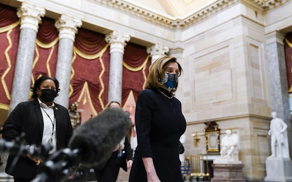 US Speaker of the House Nancy Pelosi at the Capitol in Washington, Wednesday, Jan. 13, 2021, as the House of Representatives pursues an article of impeachment against President Donald Trump for his role in inciting an angry mob to storm the Capitol last week. (AP Photo/Susan Walsh)