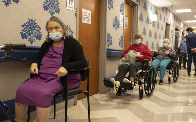 Nursing home residents in line to receive COVID-19 vaccines at Harlem Center for Nursing and Rehabilitation, a nursing home facility in New York, January 15, 2021. (AP Photo/Yuki Iwamura)