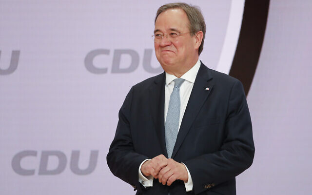 The new elected Christian Democratic Union (CDU) party chairman Armin Laschet stands on the podium after the voting at a digital party convention in Berlin, Germany, January 16, 2021. (AP Photo/Markus Schreiber)