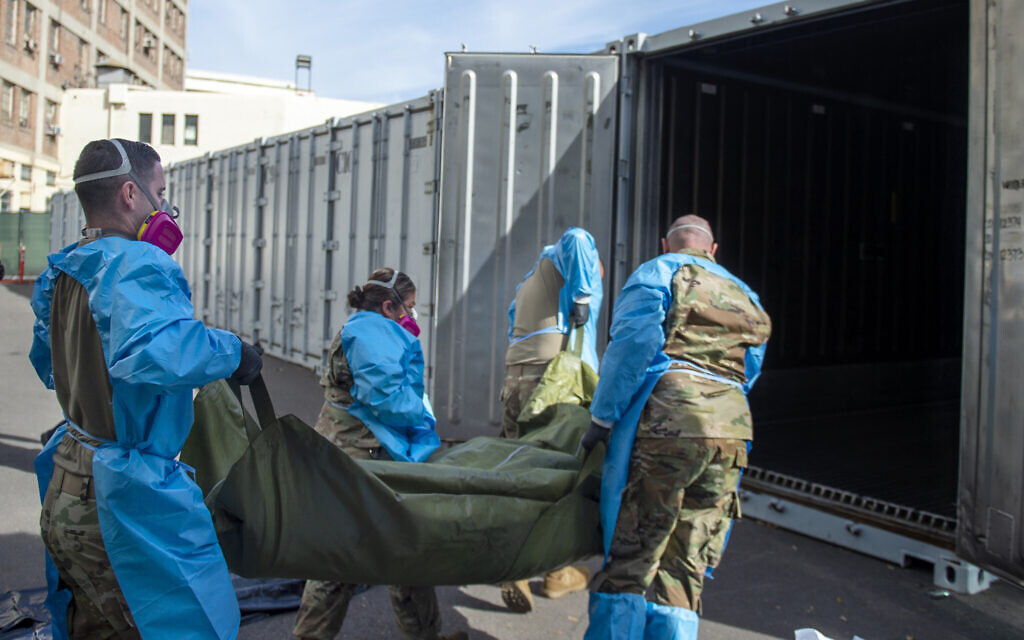 Illustrative: National Guard members assist with processing COVID-19 deaths and placing them into temporary storage at LA County Medical Examiner-Coroner Office in Los Angeles, January 12, 2021. (LA County Dept. of Medical Examiner-Coroner via AP, File)
