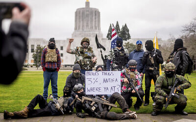 Armed protesters, who identified themselves as Liberty Boys, pose for fellow demonstrators' pictures outside the Oregon State Capitol on Jan. 17, 2021, in Salem, Oregon (AP Photo/Noah Berger)