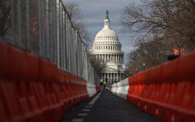 Steel fencing and barb wire surround the Capitol building as security is heightened ahead of US President-elect Joe Biden's inauguration ceremony, in Washington, January 19, 2021. (Rebecca Blackwell/AP)