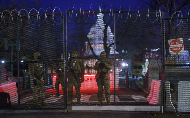 National Guard troops reinforce the security zone before US-President-elect Joe Biden is sworn in as the 46th president on Capitol Hill in Washington DC, January 19, 2021. (J. Scott Applewhite/AP)