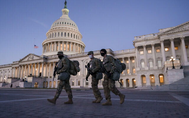National Guard troops reinforce the security zone on Capitol Hill in Washington, the day before President-elect Joe Biden is sworn in as the 46th president, January 19, 2021. (J. Scott Applewhite/AP)