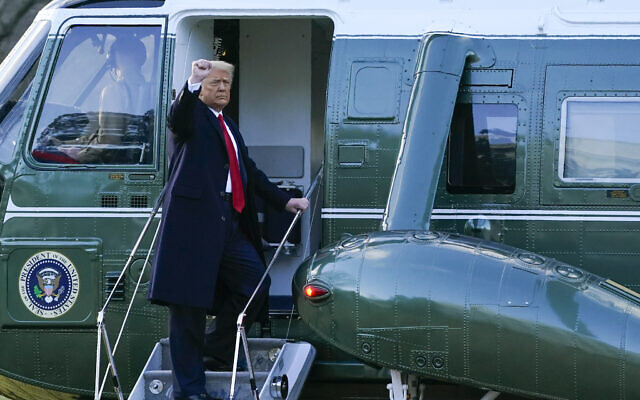 US President Donald Trump gestures as he boards Marine One on the South Lawn of the White House on Jan. 20, 2021, in Washington. Trump is en route to his Mar-a-Lago Florida Resort. (AP Photo/Alex Brandon)