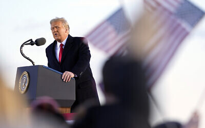 US President Donald Trump speaks before boarding Air Force One at Andrews Air Force Base, Maryland, January 20, 2021.(AP Photo/Manuel Balce Ceneta)
