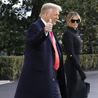 On his final day in office, then US president Donald Trump and first lady Melania Trump walk to board Marine One on the South Lawn of the White House, in Washington, January 20, 2021. (Alex Brandon/AP)
