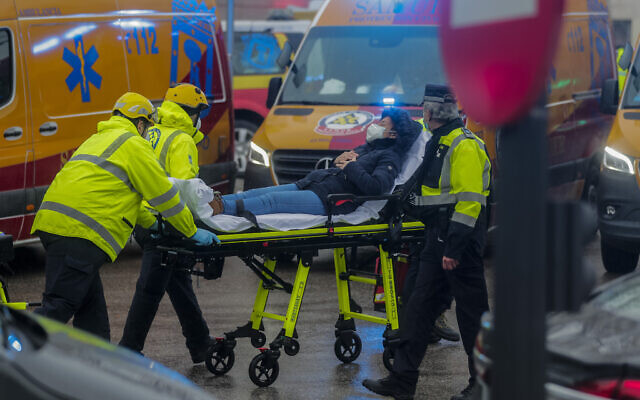 Health professionals evacuate an injured from the scene of an explosion in downtown Madrid, Spain on Jan. 20, 2021. (AP Photo/Paul White)