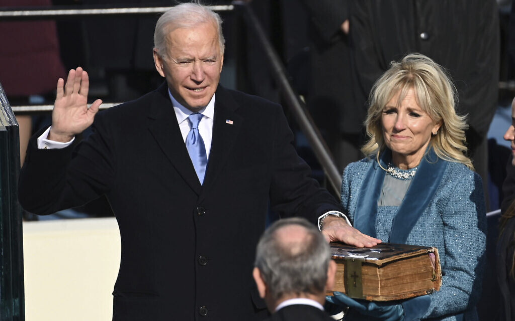 Joe Biden is sworn in as the 46th president of the United States by Chief Justice John Roberts as Jill Biden holds the Bible during the 59th Presidential Inauguration at the US Capitol in Washington, Wednesday, Jan. 20, 2021.(Saul Loeb/Pool Photo via AP)