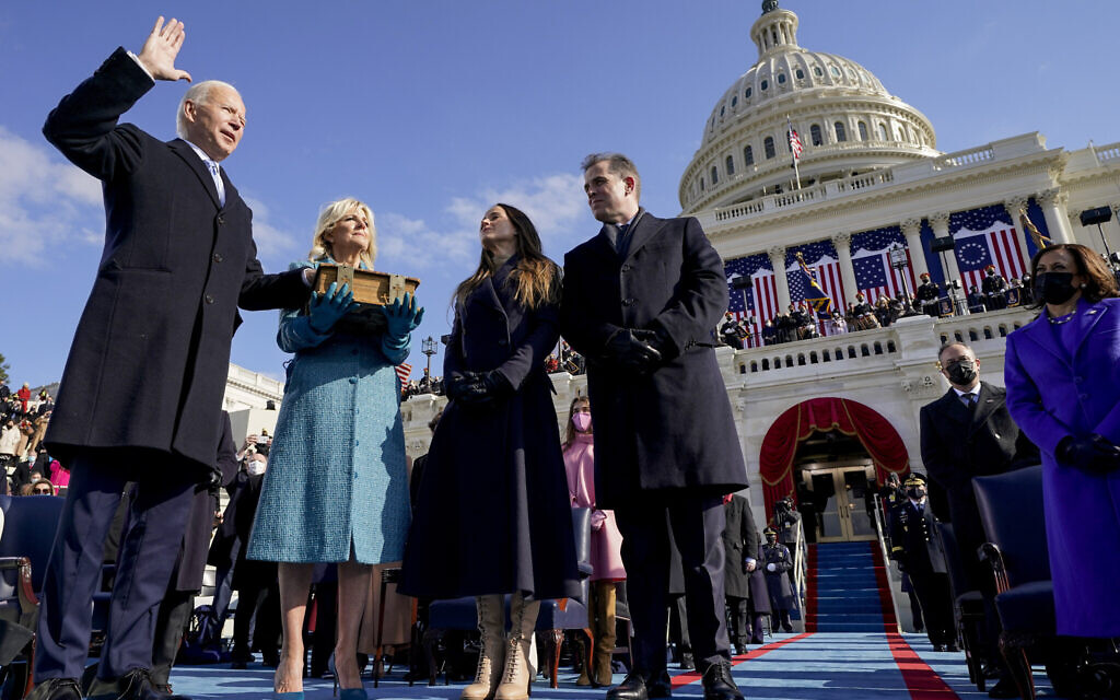 Joe Biden is sworn in as the 46th president of the United States by Chief Justice John Roberts as Jill Biden holds the Bible during the 59th Presidential Inauguration at the US Capitol in Washington, Wednesday, Jan. 20, 2021, as their children Ashley and Hunter watch.(AP Photo/Andrew Harnik, Pool)