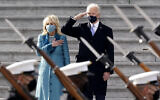 US President Joe Biden and his wife Jill Biden watch a military pass in review ceremony on the East Front of the Capitol at the conclusion of the inauguration ceremonies, in Washington, January 20, 2021. (AP/J. Scott Applewhite)