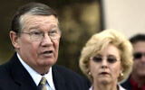 "Then-Rep. Randy ""Duke"" Cunningham, flanked by his wife Nancy, announces he will not seek reelection during a news conference in San Marcos, California, July 14, 2005. (AP Photo/Lenny Ignelzi, Files)"