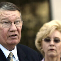 """Then-Rep. Randy """"Duke"""" Cunningham, flanked by his wife Nancy, announces he will not seek reelection during a news conference in San Marcos, California, July 14, 2005. (AP Photo/Lenny Ignelzi, Files)"""