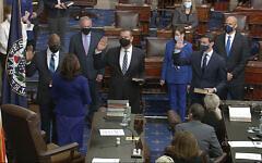 In this image from video, US Vice President Kamala Harris swears in Sen. Raphael Warnock, D-Ga., Sen. Alex Padilla, D-Calif., and Sen. Jon Ossoff, D-Ga., on the floor of the Senate Wednesday, Jan. 6, 2021, on Capitol Hill in Washington. (Senate Television via AP)