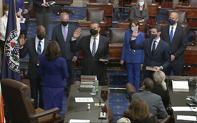 In this image from video, US Vice President Kamala Harris swears in Sen. Raphael Warnock, D-Ga., Sen. Alex Padilla, D-Calif., and Sen. Jon Ossoff, D-Ga., on the floor of the Senate Wednesday, Jan. 6, 2021, on Capitol Hill in Washington. (Senate Television via AP)