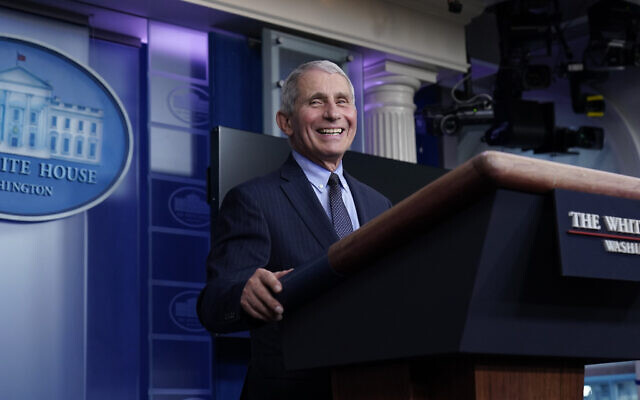 Dr. Anthony Fauci, director of the National Institute of Allergy and Infectious Diseases, laughs while speaking in the James Brady Press Briefing Room at the White House, Jan. 21, 2021, in Washington. (AP Photo/Alex Brandon)