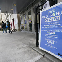 People who had appointments to get COVID-19 vaccinations talk to New York City health care workers, Jan. 21, 2021, outside a closed vaccine hub in the Brooklyn borough of New York after they were told to come back in a week due to a shortage of vaccines (AP Photo/Kathy Willens)