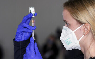 Illustrative -- A nurse draws some Moderna COVID-19 vaccine at the California Exposition & State Fair grounds in Sacramento, California, Jan. 21, 2021 (AP Photo/Rich Pedroncelli)