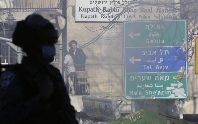 Israeli police patrol in an ultra-Orthodox neighborhood In Jerusalem, Jan. 24, 2021 (AP Photo/Sebastian Scheiner)