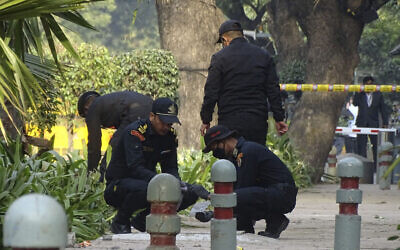 National Security Guard soldiers inspect the site of a blast near the Israeli Embassy in New Delhi, India, Jan. 30, 2021 (AP Photo/Dinesh Joshi)