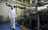 File: In this Saturday, Feb. 3, 2007 photo, an Iranian technician walks through the Uranium Conversion Facility just outside the city of Isfahan 255 miles (410 kilometers) south of the capital Tehran, Iran (AP Photo/Vahid Salemi)