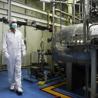 File: An Iranian technician walks through the Uranium Conversion Facility just outside the city of Isfahan 255 miles (410 kilometers) south of the capital Tehran, Iran, Saturday, Feb. 3, 2007 (AP Photo/Vahid Salemi)