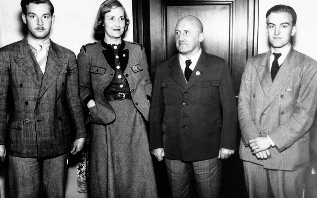 On the way from Karlsbad, Czechoslovakia, to Munich, Unity  Mitford paid a visit to the German district leader Julius Streicher at Nuremberg to make him a report of her trip throughout Sudeten-German district. Unity Mitford in Bavarian style costume with Julius Streicher, second right, at Nuremberg, Germany, on June 6, 1938. (AP Photo)