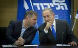 Prime Minister Benjamin Netanyahu (R) leads a Likud faction meeting in the Knesset alongside MK Yoav Kisch, January 2, 2017. (Miriam Alster/FLASH90)