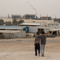 The unrecognized Bedouin villages around the Ramat Hovav industrial area in southern Israel suffer from a high level of air pollution from nearby chemical evaporation ponds and an Israel Electric Company power plant, on December 28, 2017. (Yaniv Nadav/Flash90/File)