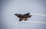 An F-35 jet maneuvers during a graduation ceremony for pilots who have completed the IAF Flight Course, at the Hatzerim Air Base in the Negev desert, December 26, 2018. (Aharon Krohn/Flash90/File)