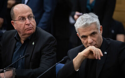 MKs Yair Lapid (L) and Moshe Ya'alon attend a faction meeting at the Knesset in Jerusalem, on December 2, 2019. (Hadas Parush/Flash90)