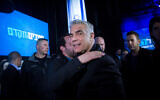 Yesh Atid leader Yair Lapid arrives at the Blue and White party headquarters in Tel Aviv, on election night, March 3, 2020. (Miriam Alster/Flash90)