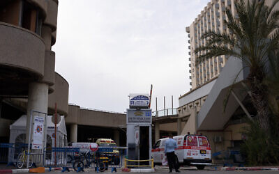 Illustrative -- A Magen David Adom ambulance enters Tel Aviv's Dan Panorama hotel which was turned into quarantine facility in Tel Aviv, on March 26, 2020 (Gili Yaari /Flash90)