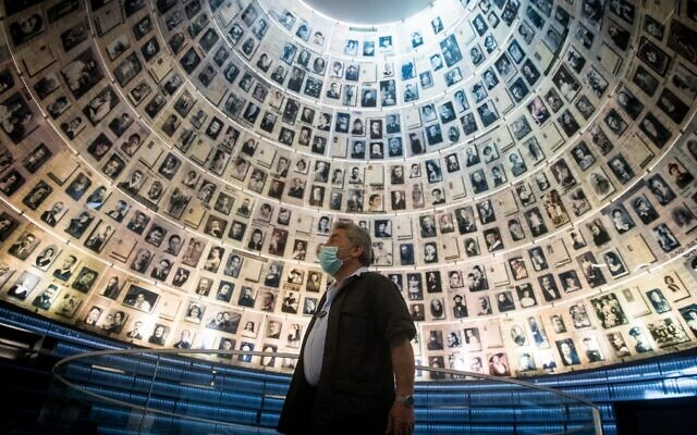 A Yad Vashem security guard in the empty Hall of Names in the Yad Vashem Holocaust Memorial Museum in Jerusalem on April 19, 2020. (Yonatan Sindel/Flash90)